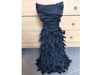 Black feathered mannequin decorative item