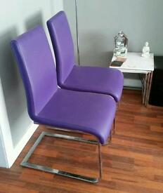 Pair of purple dining chairs from harveys