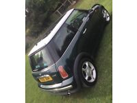 Mini Cooper 51 Plate racing green with panoramic sunroof auto 2 lady owners from new