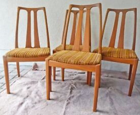 Four solid Teak Nathan Chairs.
