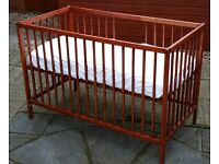 Ikea cot (painted varnish) 117 x 60cm. Plus waterproof wipe clean mattress & 3 fitted sheet covers.