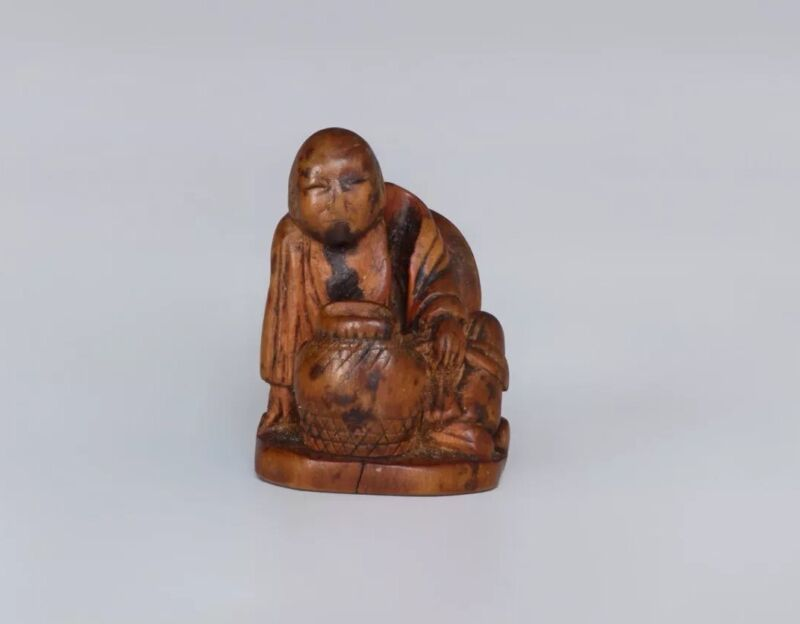 An Antique Japanese Edo Period Carved Wooden Netsuke Of A Seated Man