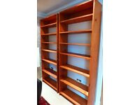 Two Oregon pine bookcases with adjustable shelves.