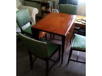 Part folding table and 4 green chairs