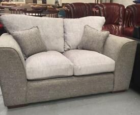 ** NEVER USED ** GREY TWO SEATER SETTEE ** CAN DELIVER **