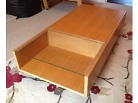 Habitat light oak coffee table with sliding top and glass extension.