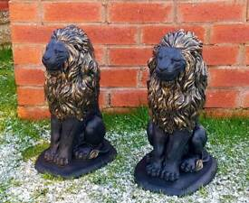 Black and gold lions x2;cast stone garden ornament
