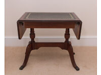 Attractive small reproduction drop-leaf coffee table. Good condition.
