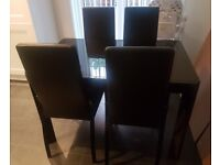 Black dining table and chairs for sale