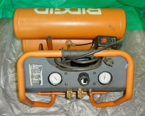 RIDGID  Twin Stack Oil-Free 4.5 Gal Portable Air Compressor. Model OF45150.