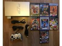 PlayStation 2 console and lots of games. Ps2