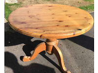 Round pine table in good condition and four pine chairs, fair condition but need some attention.