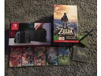 Nintendo switch inc 5 games one witch is Zelda breath of the wind limited edition