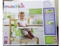 Munchkin childs adjustable booster seat for use in the home.