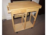 Solid pine extending study desk with two stools.