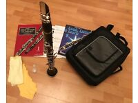Clarinet with case, books and extras