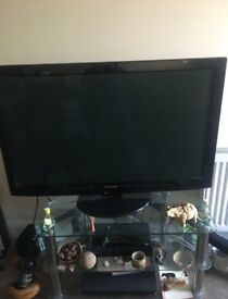 42 inch Panasonic TV with glass stand