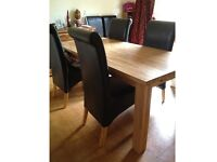 6 ft Oak table extends to 8 ft, with 6 real leather chairs