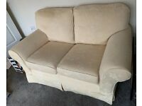 Sofas - Set of two cream sofas with white detail. Used but great condition