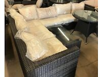 Rattan corner sofa and coffee table mixed brown cream cushions