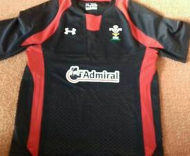 "Wales Black Underarmour youth extra large Rugby Shirt. Pit to Pit 19"" (38"" chest?)"