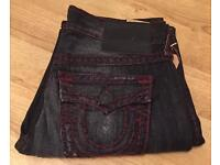 Brand new with tags authentic men's True Religion jeans. Ricky style. Waist 33. Thick stitch.