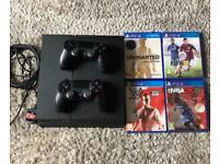 PS4 with two controllers and games