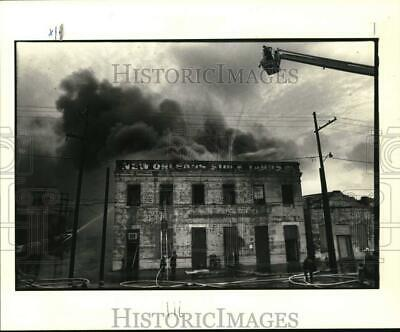 1983 Press Photo Historic building on Peters Street in Arabi on fire On Fire Photo