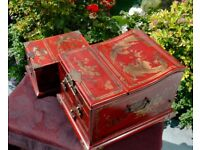 Two lacquered red jewellery box's with Dragons in gold
