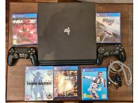 Sony PlayStation 4 Pro (1TB Black) with 2 original DualShock 4 controllers + 5 PS4 games