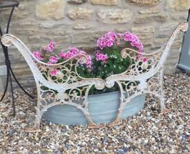 A pair of vintage/antique cast iron lion face bench ends