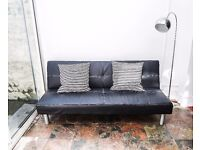 Black faux leather Sofa Bed for sale in MINT condition + Lamp