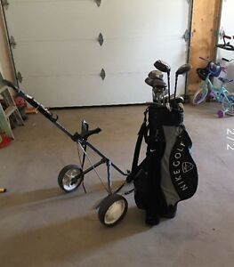 Woman's Golf clubs, cart and shoes