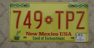 56 - NEW MEXICO YELLOW ZIA LICENSE PLATE 749-TPZ