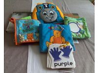Seven different young children books, four are made of cloth, the other picture cardboard.