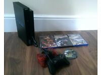 EXCELLENT CONDITION SONY PLAYSTATION 2 (PS2) WITH 2 CONTROLLERS & 4 TOP GAMES