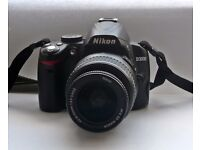 Nikon D3000 camera with accessories