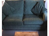 Clean tidy green sofa bed