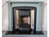 Cast iron fireplace with period tile detail, polished granite hearth and wooden surround