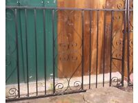 A pair of wrought iron gates have been shot blasted back to bare metal and powder coated black