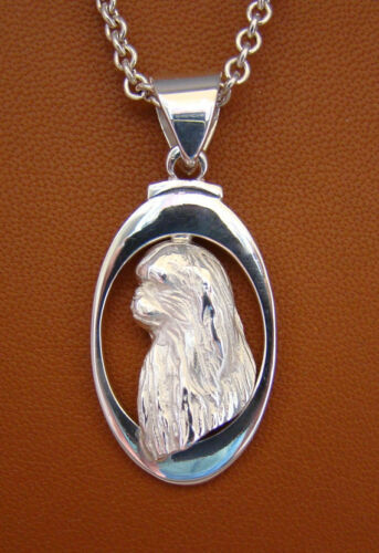 Sterling Silver Japanese Chin Head Study On A Vertical Oval Frame Pendant