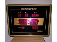 BLACK AND GOLD DIGITAL CLOCK WITH TIME, TEMP AND DAY DISPLAY
