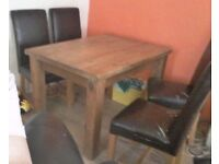 Solid oak dining table plus 4 leatherette chairs.