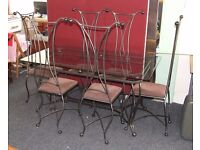 Stylish wrought iron and glass dining set. Delivery available.