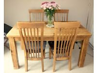 Solid Wood Dining Table and 4 matching chairs.