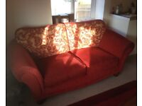 Red 2 seater sofa reversible cushions