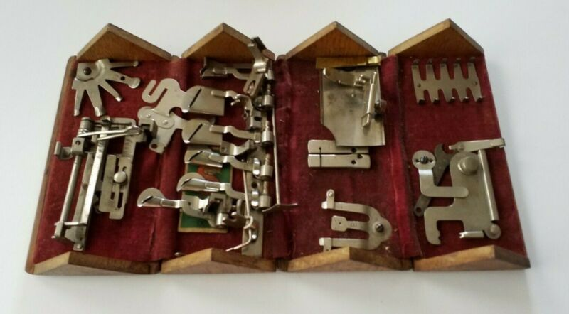 Antique Singer sewing attachments puzzle box