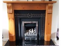 Fireplace in Victorian pine, cast iron backplate, coal effect gas fire & black granite hearth