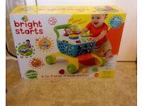 Brand new, still in box, bright starts walker