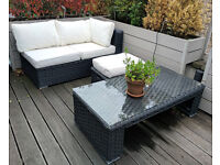 Rattan woven outdoor furniture - Great Condition - 3x 2seaters, glass-topped table, 2x foot stools